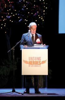 Donald Manelli accepting the Unsung Hero of  Los Angeles award.